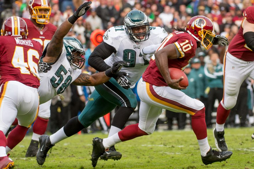 Washington Redskins quarterback Robert Griffin III (10) scrambles in the second quarter as the Washington Redskins play the Philadelphia Eagles at FedEx Field, Landover, Md., Sunday, Nov. 18, 2012. (Andrew Harnik/The Washington Times)