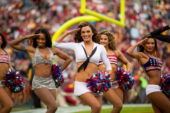 Washington Redskins cheerleaders perform in military style costumes as part of the NFL's military salute to service as the Washington Redskins play the Philadelphia Eagles at FedEx Field, Landover, Md., Sunday, Nov. 18, 2012. (Andrew Harnik/The Washington Times)
