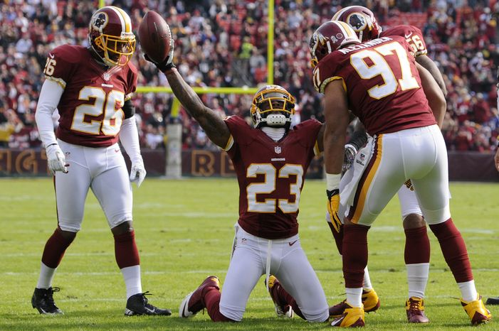 Washington Redskins cornerback DeAngelo Hall (23) celebrates his first quarter interception that set up the teams first touchdown in the first quarter at FedEx Field, Landover, Md., Nov. 18, 2012. (Preston Keres/Special to The Washington Times)