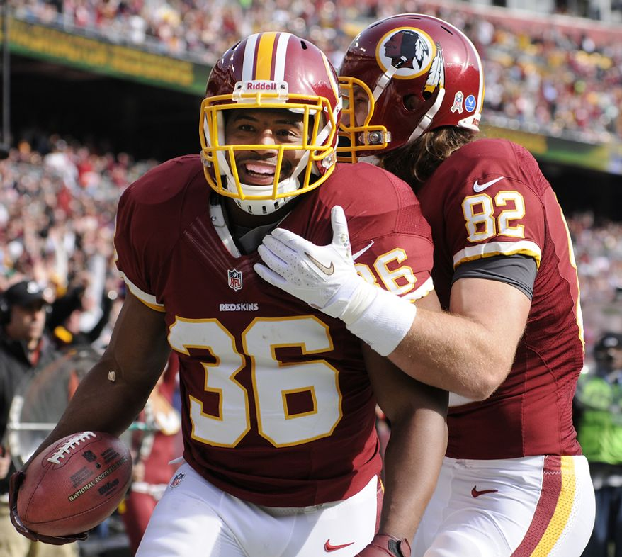 Washington Redskins fullback Darrel Young (36) celebrates his first-quarter touchdown with tight end Logan Paulsen (82) at FedEx Field, Landover, Md., Nov. 18, 2012. (Preston Keres/Special to The Washington Times)