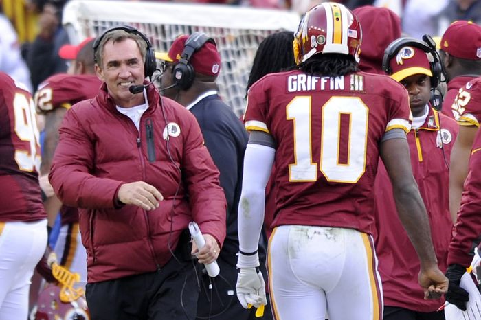 Washington Redskins head coach Mike Shanahan is all smiles as quarterback Robert Griffin III (10) comes to the bench following his 61-yard touchdown pass in the third quarter at FedEx Field, Landover, Md., Nov. 18, 2012. (Preston Keres/Special to The Washington Times)