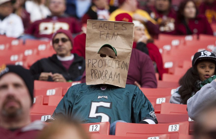 Philadelphia Eagles fans wear bags over their head in the fourth quarter against the Washington Redskins, Landover, Md., Sunday, November 18, 2012.  (Craig Bisacre/The Washington Times)