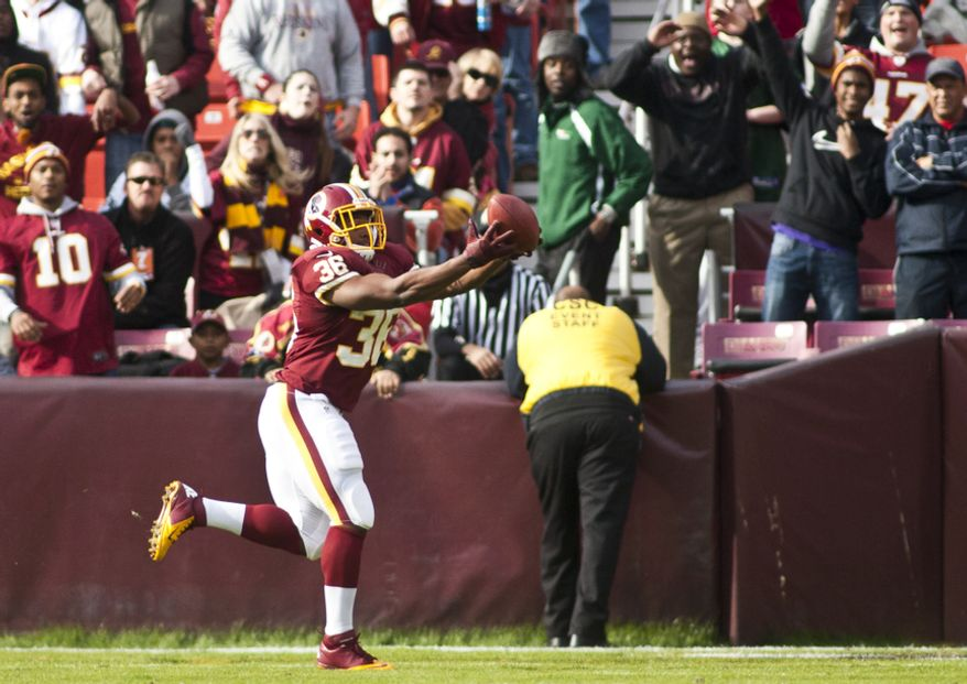Washington Redskins fullback Darrel Young (36) catches a touchdown pass from Washington Redskins quarterback Robert Griffin III (10) in the second quarter against the Philadelphia Eagles, Landover, Md., Sunday, November 18, 2012.  (Craig Bisacre/The Washington Times)