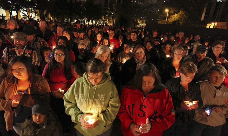 About 200 people attend a candlelight vigil held at Centennial Plaza in Midland, Texas on Saturday, Nov. 17, 2012, in honor of the people involved in an accident where a Union Pacific train struck a float carrying military veterans on Thursday Nov. 15, 2012. Four veterans were killed, including one from the San Antonio area. (AP Photo/San Antonio Express-News, Edward A. Ornelas)