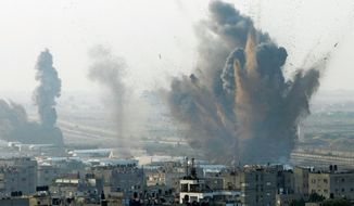Smoke rises Monday after an Israeli attack on smuggling tunnels on the border between Egypt and Rafah, in the southern Gaza Strip. Egypt has been mediating indirect talks between Israeli and Palestinian officials. (Associated Press)