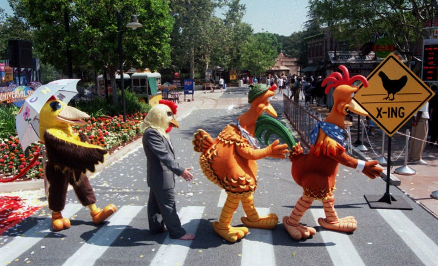"Characters from the recently-opened Universal Studios' release ""Chicken Run"" mimic a scene in a photo of the Beatles used as the cover for the band's ""Abbey Road"" album, during the opening ceremonies for a new attraction called ""Chicken Run Maze,"" which is based on the movie, at Universal Studios Hollywood in Universal City, Calif., Tuesday, June 20, 2000. (AP Photo/Universal Studios Hollywood, Michael Tweed)"