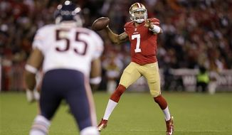 San Francisco 49ers quarterback Colin Kaepernick (7) passes against the Chicago Bears during the second half of an NFL game in San Francisco, Monday, Nov. 19, 2012. (AP Photo/Marcio Jose Sanchez)