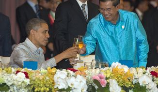 President Obama toasts with Cambodia's Prime Minister Hun Sen at the East Asia Summit Dinner during the East Asia Summit at the Diamond Island Convention Center in Phnom Penh, Cambodia, on Nov. 19, 2012. (Associated Press)