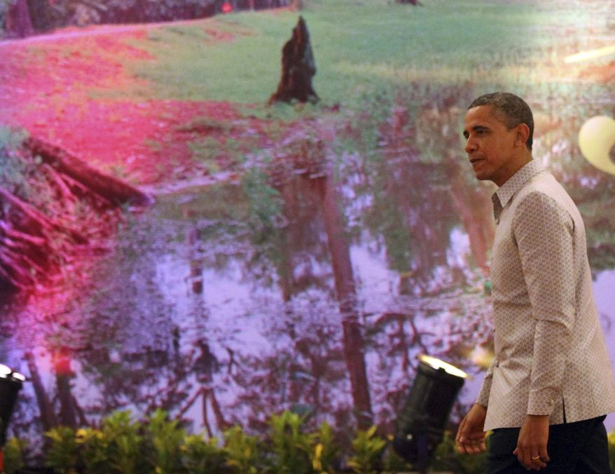 President Obama walks to the reception room past a wall decoration prior to the gala dinner in Phnom Penh, Cambodia, on Nov. 19, 2012. Obama is in Cambodia on the final leg of his three-country tour of Southeast Asia. (Associated Press)