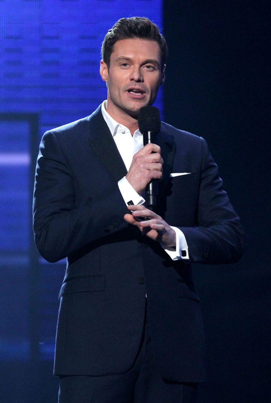 Ryan Seacrest presents the award for favorite male artist in the pop/rock category at the 40th Annual American Music Awards in Los Angeles on Nov. 18, 2012. (Matt Sayles/Invision/Associated Press)