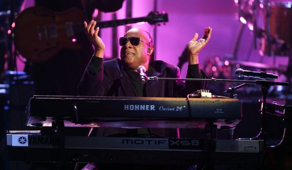 "Stevie Wonder and the Rickey Minor Band perform ""Master Blaster,"" ""My Cherie Amour"" and ""Sir Duke"" during a tribute to Dick Clark at the 40th Anniversary American Music Awards in Los Angeles on Nov. 18, 2012. (John Shearer/Invision/Associated Press)"