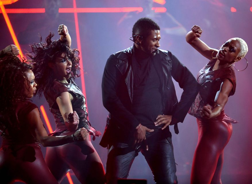 Usher performs at the 40th Annual American Music Awards in Los Angeles on Nov. 18, 2012. (John Shearer/Invision/Associated Press)