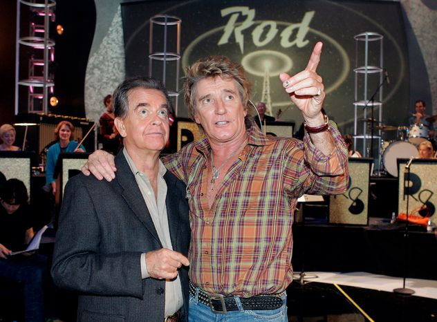 **FILE** Dick Clark (left) talks Nov. 12, 2004, with singer Rod Stewart during rehearsals for the American Music Awards in Los Angeles. (Associated Press)