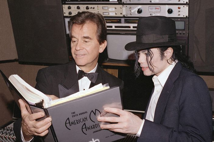 **FILE** Michael Jackson and Dick Clark go over the script during rehearsals for the American Music Awards at the Shrine Auditorium in Los Angeles on Jan. 24, 1993. (Associated