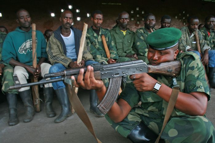 **FILE** M23 rebels conduct training exercises in Rumangabo, Congo, on Oct. 23, 2012. (Associated Press)