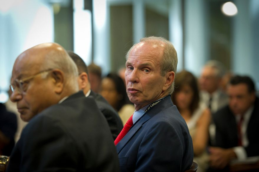 **FILE** Buddy Roogow, D.C. Lottery Executive Director, testifies June 29, 2011, at the Wilson Building in Washington, D.C., before a city council hearing regarding online poker in D.C. (Rod Lamkey Jr./The Washington Times)