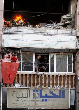 Fire is seen  from the explosion at a high rise housing media organizations in Gaza City, Monday, Nov. 19, 2012. It's the Israel's military second strike on the building in two days. The Hamas TV station, Al Aqsa, is located on the top floor. (AP Photo/Hatem Moussa)