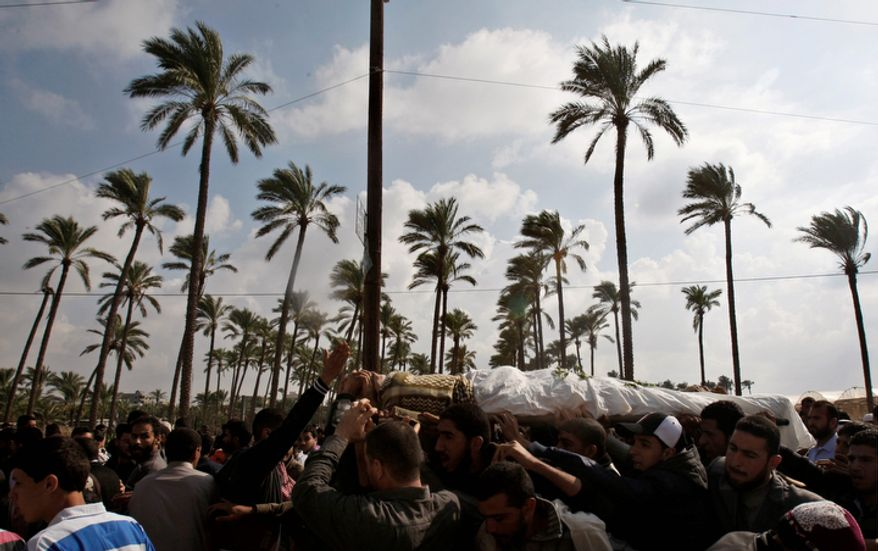 Palestinian mourners carry the body of farmer Amin Bashir, 40, during his funeral in Deir Al Balah, central Gaza Strip, Monday, Nov. 19, 2012. The Palestinian civilian death toll mounted Monday as Israeli aircraft struck densely populated areas in the Gaza Strip in its campaign to quell militant rocket fire menacing nearly half of Israel's population. (AP Photo/Adel Hana)