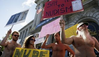 Demonstrators gather Nov. 14, 2012, at a protest against a proposed nudity ban outside of City Hall in San Francisco. (Associated Press)
