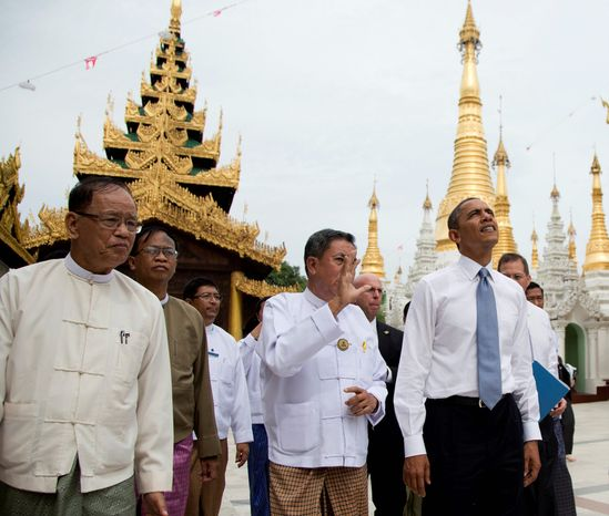 President Obama (right) tours the Shwedagon Pagoda in Yangon, Myanmar, on Nov. 19, 2012. In a historic trip to a long shunned land, Obama showered praise and promises of more U.S.