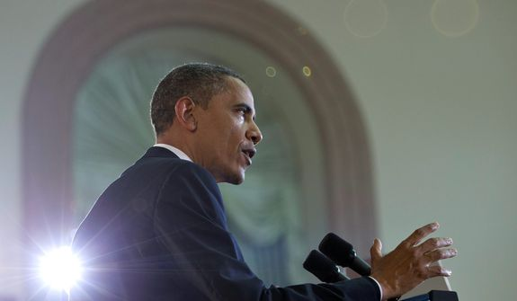 President Obama speaks Nov. 19, 2012, at University of Yangon in Yangon, Myanmar. In a historic trip to a long shunned land, Obama showered praise and promises of more U.S. help to Myanmar if the Asian nation keeps building its new democracy. (Associated Press