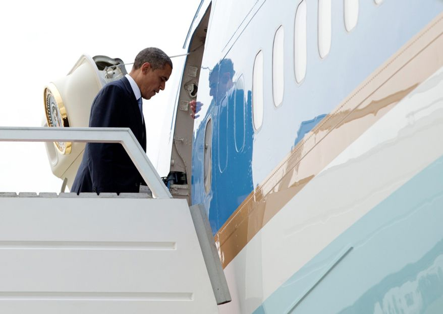 President Obama boards Air Force One at Yangon International Airport in Yangon, Myanmar, on Nov. 19, 2012, en route to Phnom Penh International Airport in Phnom Penh, Cambodia, where he will attend the East Asia Summit. (Associated Press)