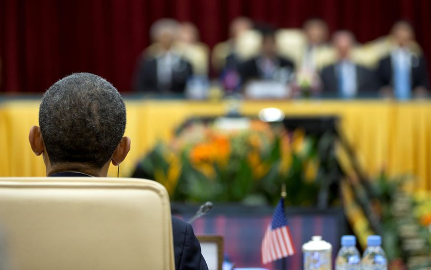 President Obama is seen from behind as he attends the East Asia Summit at the Peace Palace in Phnom Penh, Cambodia, on Nov. 19, 2012. (Associated Press)