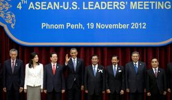 President Obama (fourth from left) waves as he stands with ASEAN leaders for a group photo during the ASEAN-U.S. leaders' meeting at the Peace Palace in Phnom Penh, Cambodia, on Nov. 19, 2012. They are (from left) Singapore's Prime Minister Lee Hsien Loong, Thailand's Prime Minister Yingluck Shinawatra, Vietnam's Prime Minister Nguyen Tan Dung, Obama, Cambodia's Prime Minister Hun Sen, Brunei's Sultan Hassanal Bolkiah, Indonesia's President Susilo Bambang Yudhoyono and Laos Prime Minister Thongsing Thammavong. (Associated Press)