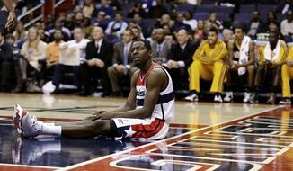 Washington Wizards guard Jordan Crawford pauses on the court during the first half of an NBA game against the Indiana Pacers on Monday, Nov. 19, 2012, in Washington. The Pacers won 96-89. (AP Photo/Alex Brandon)