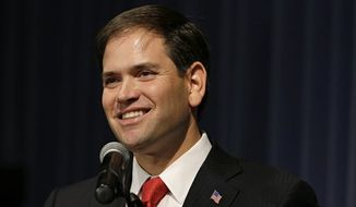 **FILE** Sen. Marco Rubio, Florida Republican, speaks Nov. 17, 2012, during Iowa Gov. Terry Branstad's annual birthday fundraiser in Altoona, Iowa. (Associated Press)