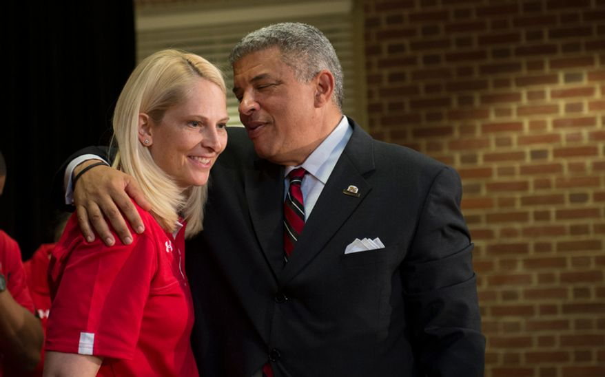 University of Maryland women's basketball head coach Brenda Frese (left) is embraced by Kevin Anderson, University of Maryland Director of Athletics following a press conference to announce the University of Maryland's joining the Big Ten Conference, at the University of Maryland in College Park, Md., Monday, Nov. 19, 2012. (Rod Lamkey Jr./The Washington Times)