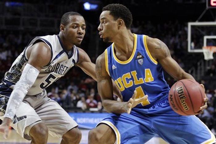 UCLA's Norman Powell (4) protects the ball from Georgetown's Jabril Trawick in the first half of their NCAA basketball game in the Legends Classic, Monday, Nov. 19, 2012, in Brooklyn, New York. (AP Photo/Frank Franklin II)