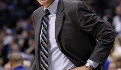 Washington Wizards head coach Randy Wittman shouts at an official after a call in the first half of an NBA basketball game against the Dallas Mavericks, Wednesday, Nov. 14, 2012, in Dallas. (AP Photo/Tony Gutierrez)