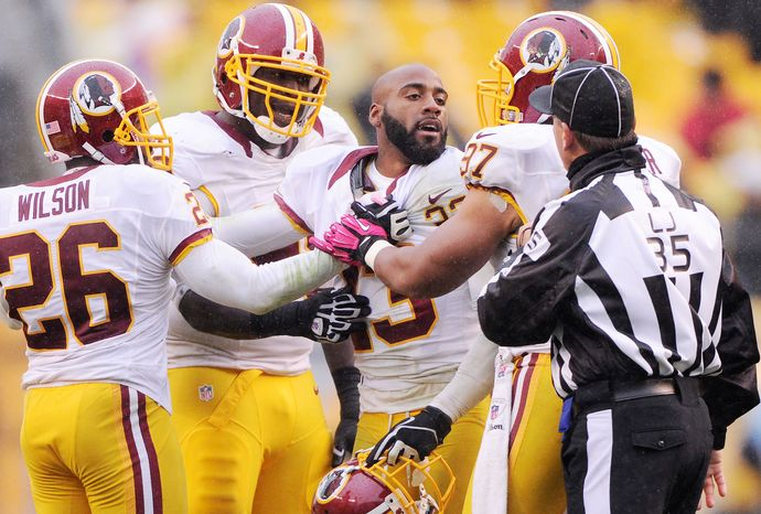 Washington Redskins cornerback DeAngelo Hall (23) is held back by teammates as he argues with the line judge John Hussey at Heinz Field, Pittsburgh, Pa., Oct. 28, 2012. (Preston Keres/Special to The Washington Times)