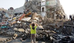 A house in Gaza City was turned to rubble by an Israeli airstrike Tuesday. Efforts to end the week-old convulsion of Israeli-Palestinian violence drew in top diplomats, including appeals from Secretary of State Hillary Rodham Clinton and U.N. Secretary-General Ban Ki-moon. (Associated Press)