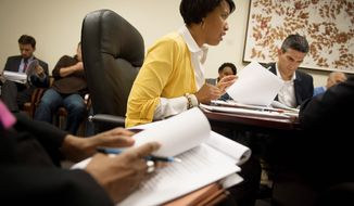 Committee on Government Operations Chairman Muriel Bowser, Ward 4 Democrat, asks a question of D.C. Attorney General Irvin B. Nathan on ways to improve campaign finance rules during a meeting Tuesday with other D.C. Council members. (Rod Lamkey Jr./The Washington Times)