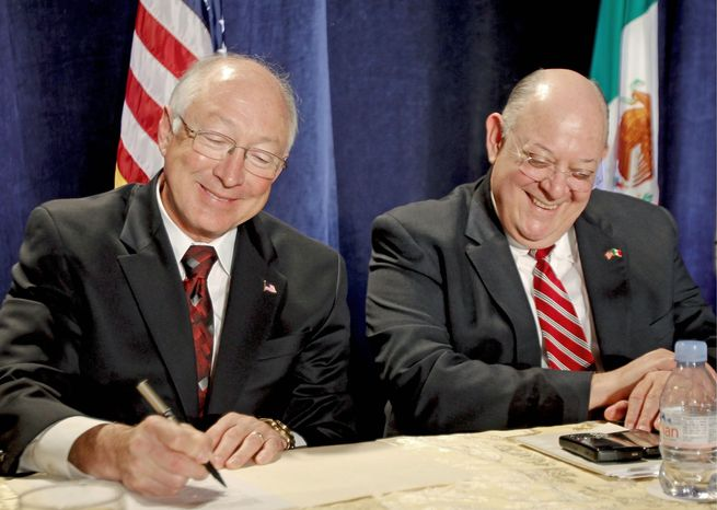 U.S. Interior Secretary Kenneth L. Salazar signs an agreement on Colorado River water usage as Mexican Commissioner Roberto Salmon looks on Tuesday. It amends a 1944 treaty granting Mexico 1.5 million acre-feet of river water yearly. (Associated Press)