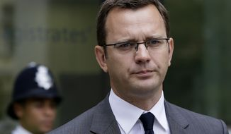 **FILE** Andy Coulson, former chief communications adviser for British Prime Minister David Cameron and former editor of the News of the World, is seen here in London on Aug. 16, 2012, after appearing in Westminster Magistrates Court on phone hacking charges. (Associated Press)