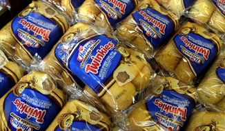 **FILE** Twinkies baked goods are displayed for sale Nov. 16, 2012, at the Hostess Brands' bakery in Denver. (Associated Press)
