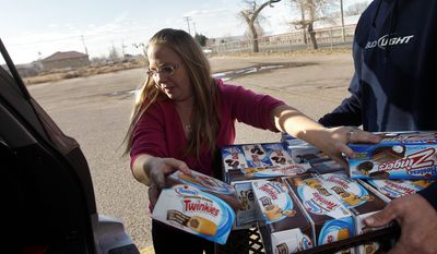 Michelle Craft, of Thornton, Colo., loads boxes of Twinkies and Zingers into her car after buying about $100 worth of the baked goods at the Hostess Brands' bakery in Denver on Nov. 16, 2012. Announcements that Hostess Brands will be going out of business prompted a buyers' run on the bakery. (Associated Press)