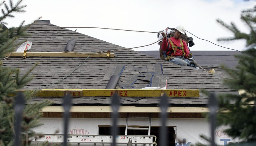 **FILE** Workers construct a new home in Chicago on Oct. 12, 2012. (Associated Press)