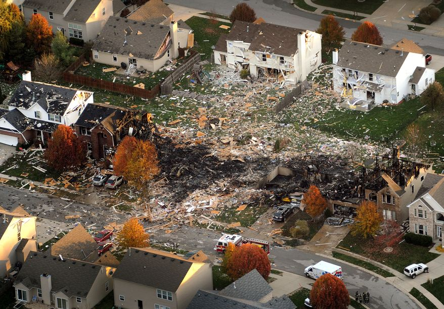 **FILE** This aerial file photo from Nov. 11, 2012, shows the two homes that were leveled and the numerous neighboring homes that were damaged from a massive explosion that sparked a huge fire and killed two people in Indianapolis. (Associated Press/The Indianapolis Star, Matt Kryger)