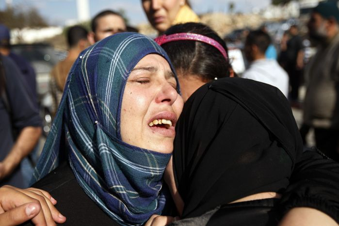 Relatives grieve Rushdi Tamimi during his funeral in the West Bank city of Ramallah on Nov. 20, 2012. Tamimi was wounded three days earlier during a protest against Israel's operation in Gaza. (Associated Press)