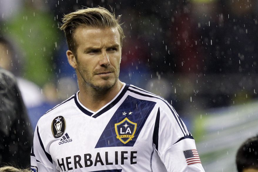 FILE - In this Nov. 18, 2012, file photo, Los Angeles Galaxy's David Beckham appears on the pitch before their MLS Western Conference championship soccer match against the Seattle Sounders in Seattle. Beckham and the Galaxy announced Monday that he will play his final match for the club in the MLS Cup next month. Los Angeles is scheduled to face Houston for the MLS title on Dec. 1. (AP Photo/Ted S. Warren, File)
