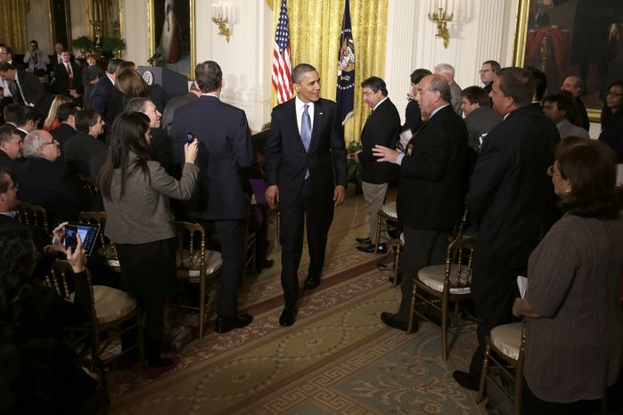 **FILE** President Obama leaves the East Room of the White House on Nov. 14, 2012, following his first post-election news conference. (Associate