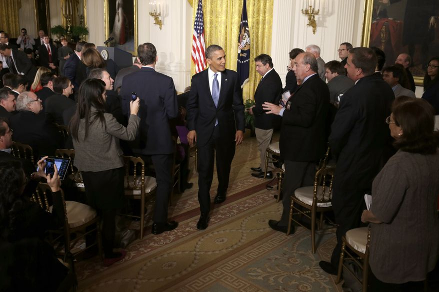 **FILE** President Obama leaves the East Room of the White House on Nov. 14, 2012, following his first post-election news conference. (Associated Press)