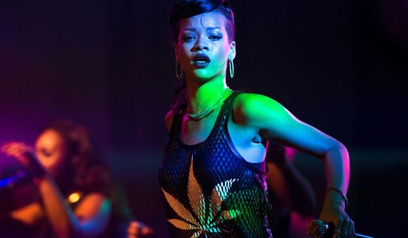 "Barbadian singer Rihanna performs during the fifth stop of her ""777"" worldwide tour at the E-Werk club in Berlin on Nov. 19, 2012. (Associated Press)"