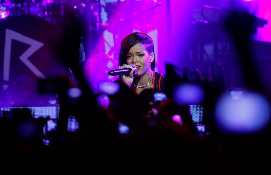 """Barbadian singer Rihanna performs during the first stop of her """"777"""" worldwide tour at the Plaza Condesa in Mexico City on Nov. 14, 2012. (Associated Press)"""
