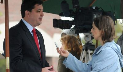Sen. David Rouzer talks with media outside precinct H02 at the Northeast Regional Library, Tuesday Nov. 6, 2012, in Wilmington, N.C. Rouzer is running for a seat in Congress, representing the state's 7th District. (AP Photo/The Star-News, Paul Stephen)