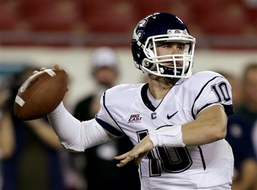 Connecticut quarterback Chandler Whitmer (10) fires a pass during the first half of an NCAA football game against the South Florida, Saturday, Nov. 3, 2012, in Tampa, Fla. (AP Photo/Chris O'Meara)